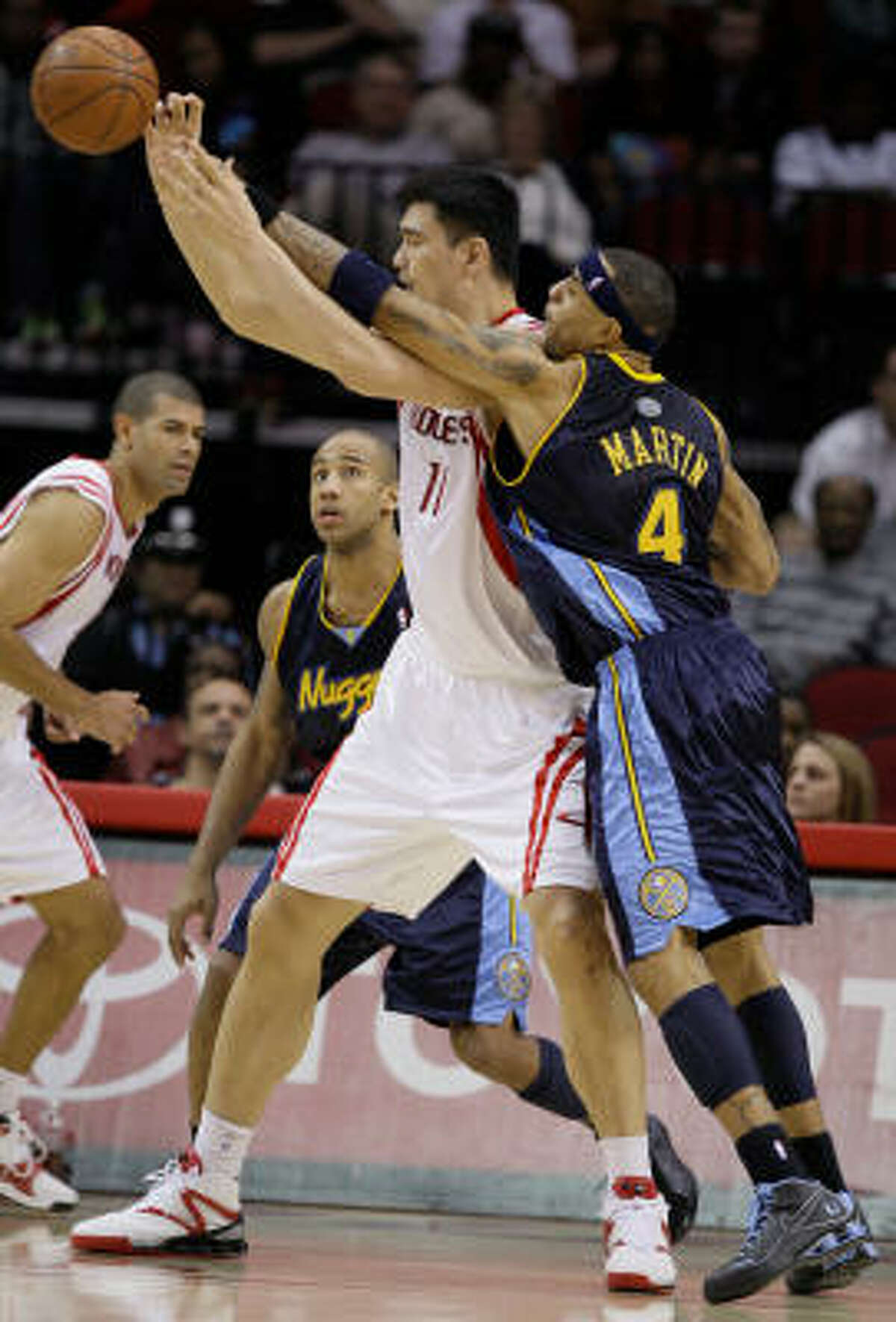 Denver's Kenyon Martin knocks the ball away from Yao Ming in the second half.