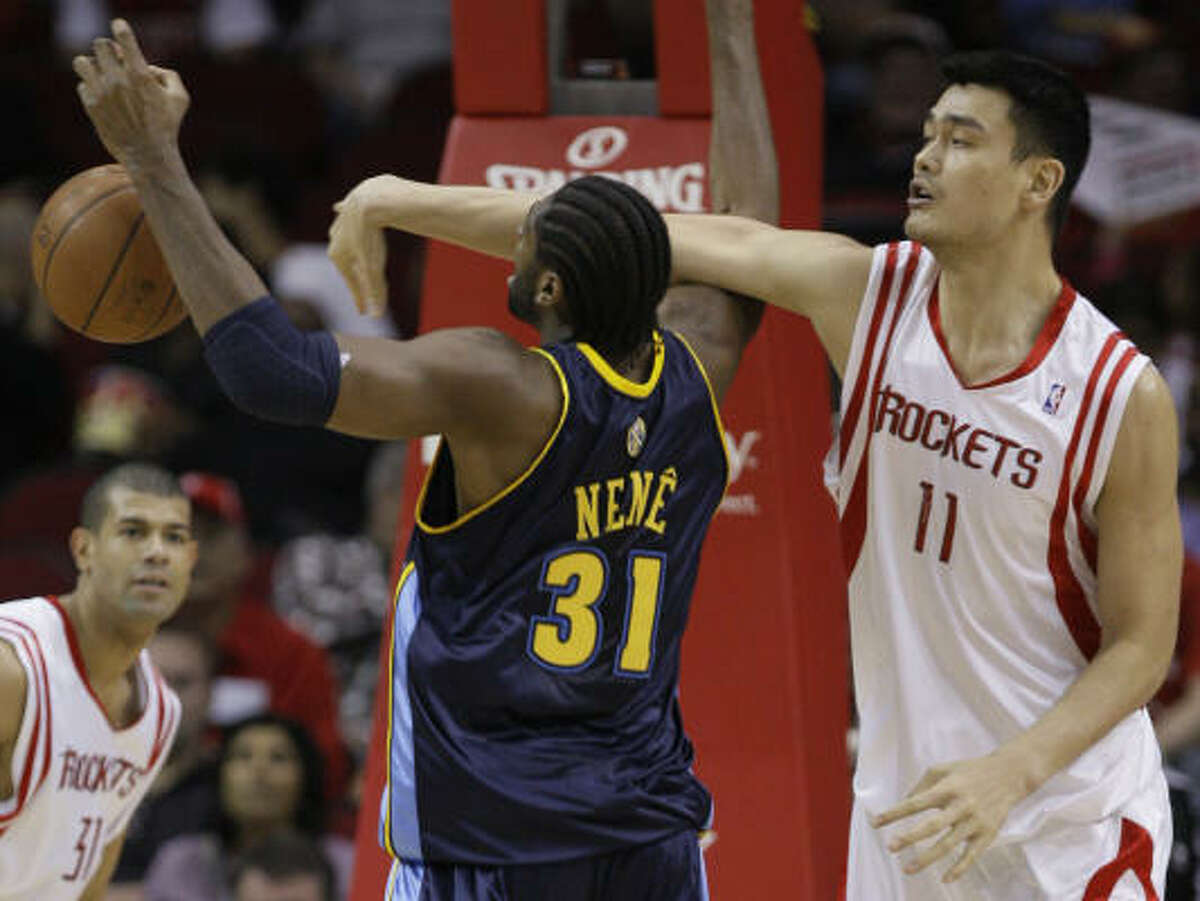 Another shot of Yao Ming. This time the Rockets star knocks the ball away from Nuggets center Nene in the first half.