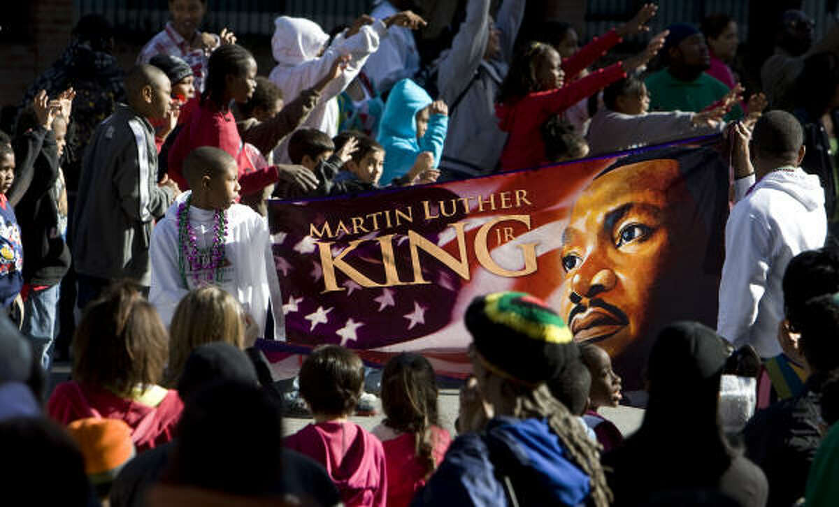A flag of Martin Luther King Jr. is shown during the MLK Parade Foundation's 15th Annual MLK Grande Parade in Houston.