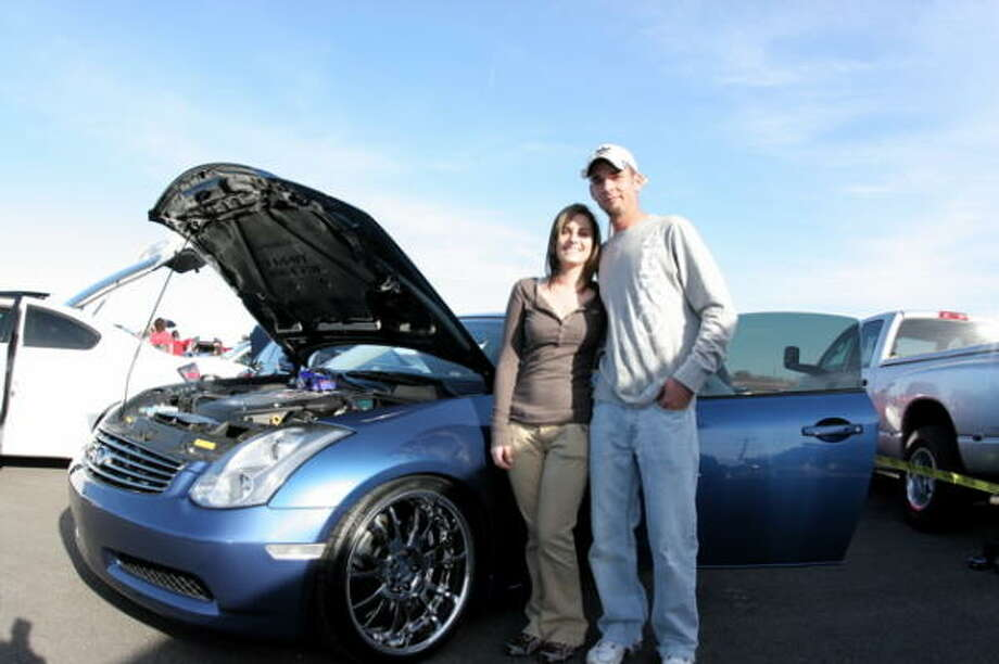Brittney Stepp, left, and Jamie LeBlanc in front of Brittney's 2006 Infiniti G35. Photo: Jordan Graber, For The Chronicle