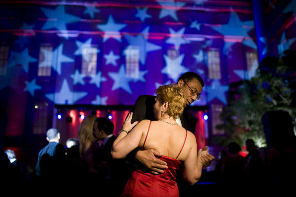 Lee Outlaw of Vienna, Va., dances with Sherry Giovannoni of Maryland during the 'Lincoln 2.0 Inaugural Ball' on Sunday in Washington.
