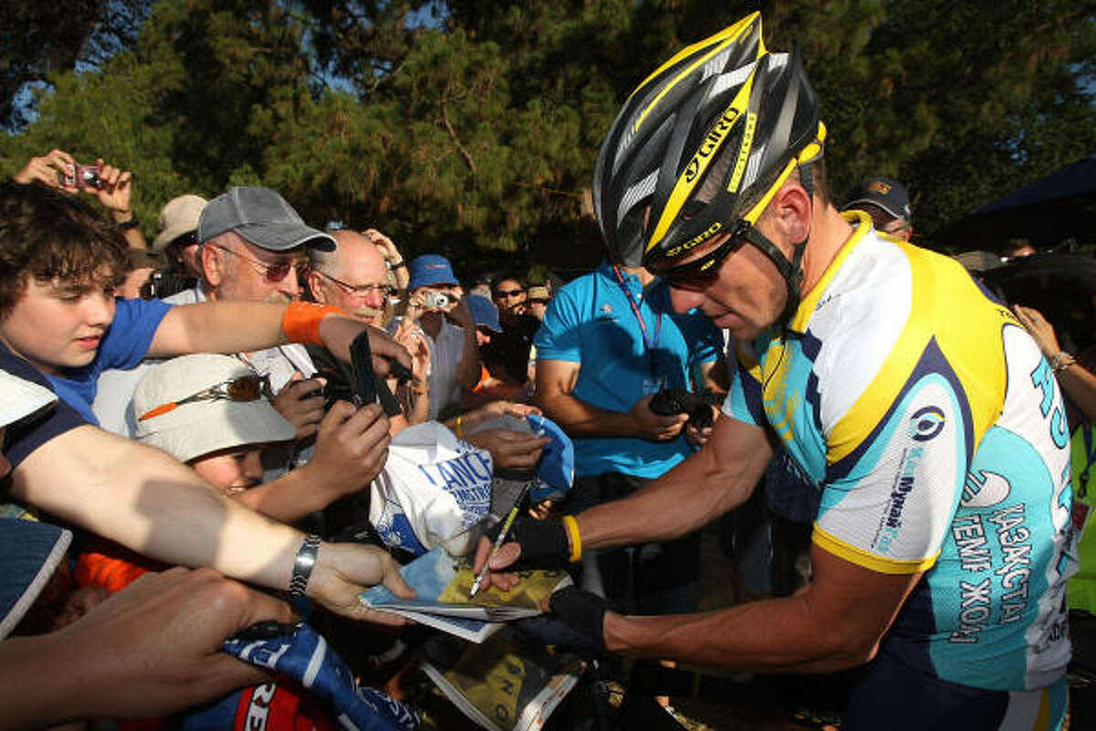 Lance Armstrong signs autographs before the Down Under Classic criterium, held in conjuction with the Tour Down Under which begins on Tuesday.