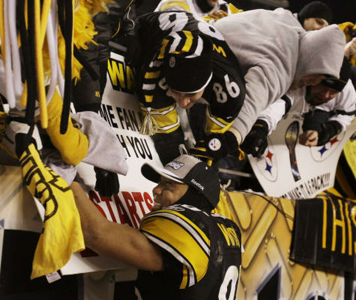 Steelers wide receiver Hines Ward celebrates with fans after the win.