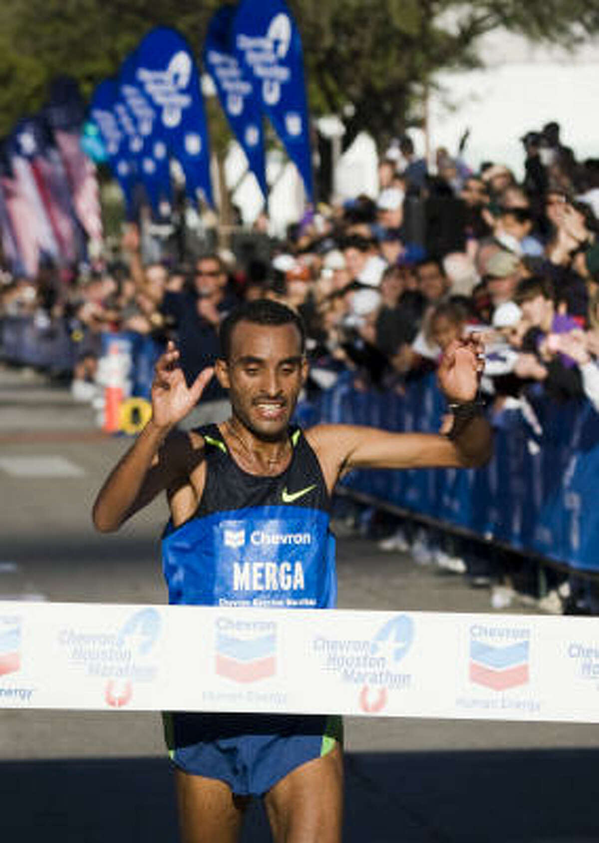 Deriba Merga of Ethiopia crosses the finish line to win the 2009 Chevron Houston Marathon with a course record time of 2:07:52.