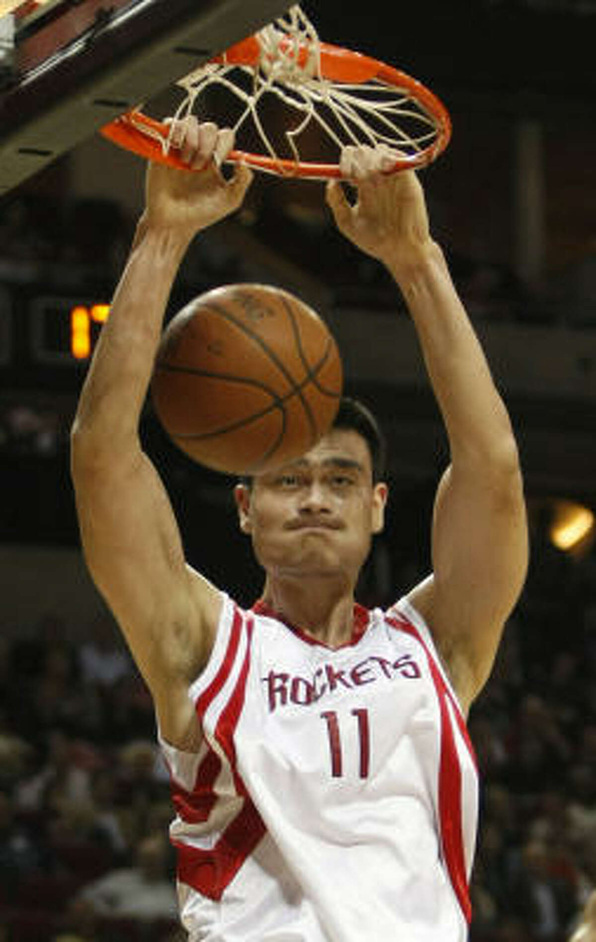 Yao Ming, who scored 26 points on 12-of-12 shooting, dunks during the first quarter.