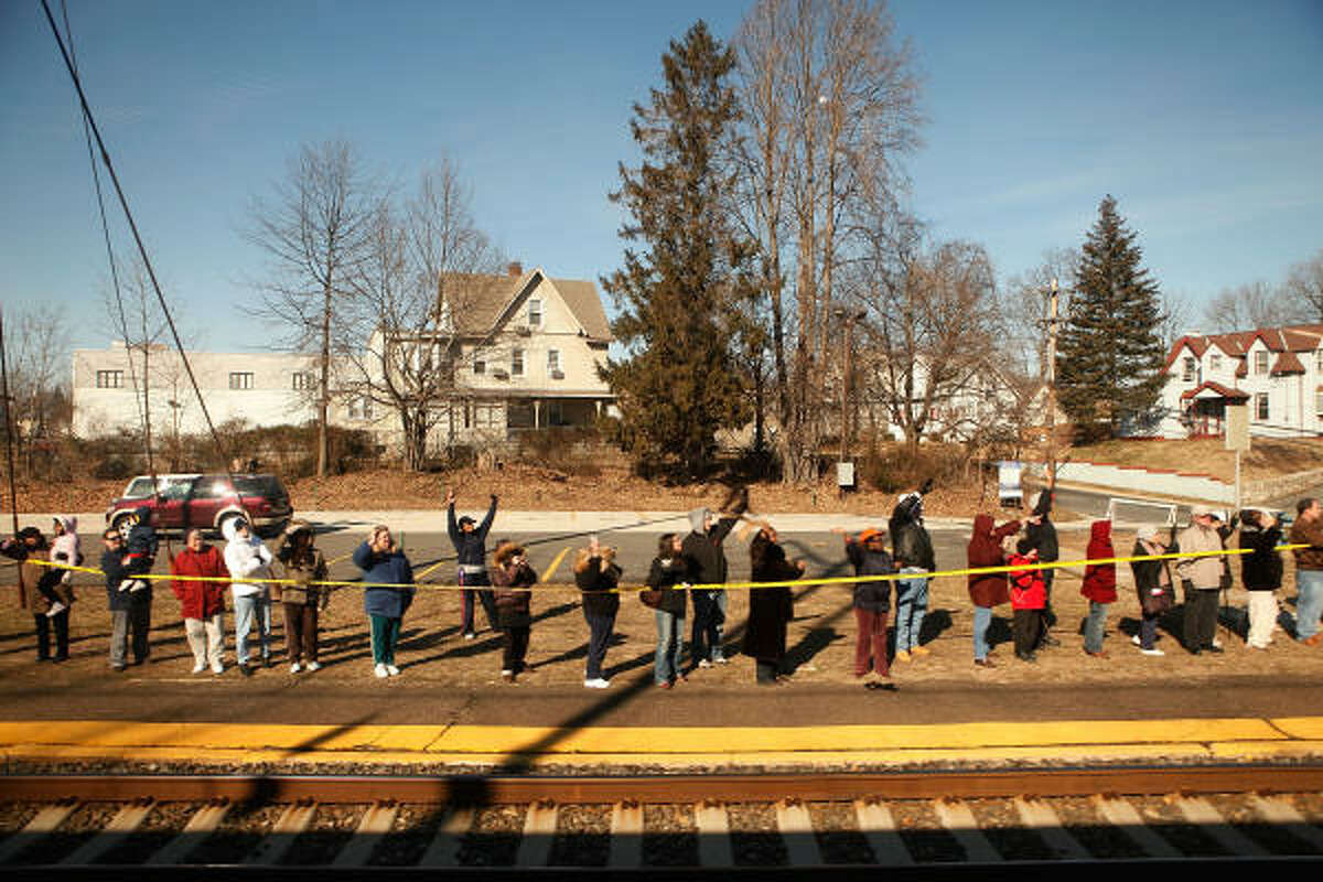 People greet the train carrying Obama and Biden to the capital.