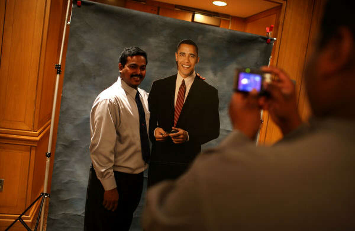 Samuel Donda has his picture taken with a cardboard standup of Barack Obama during the People's Inaugural Gala Celebration Jan. 17 in Washington, D.C.