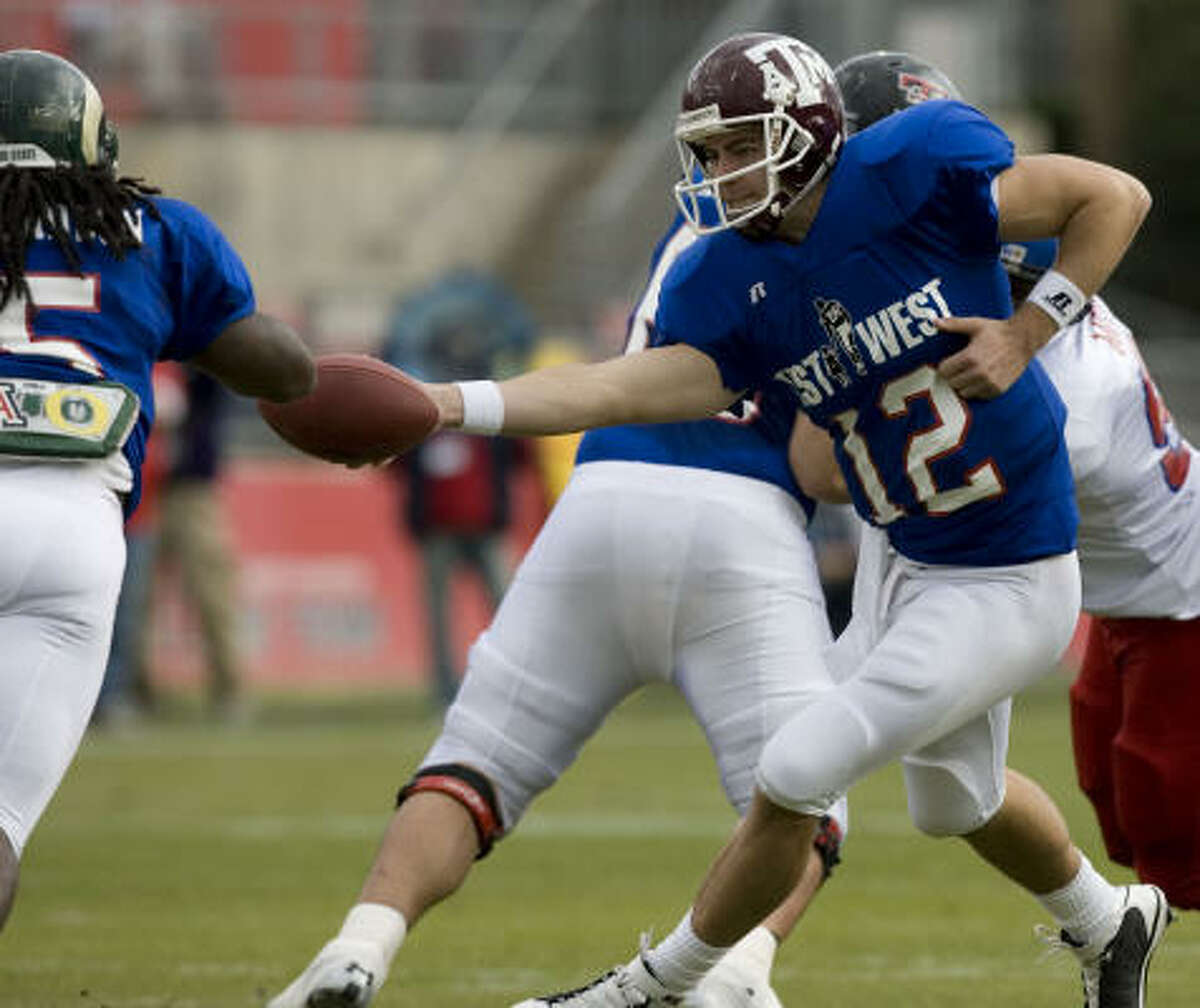 West's QB Stephen McGee, from Texas A&M, hands off to Gartrell Johnson (5) in the first half.