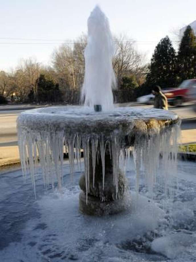 With a hard freeze overnight, the water fountain along Church Street in Spartanburg, S.C, created icicles. Photo: JOHN BYRUM, Spartanburg Herald-Journal