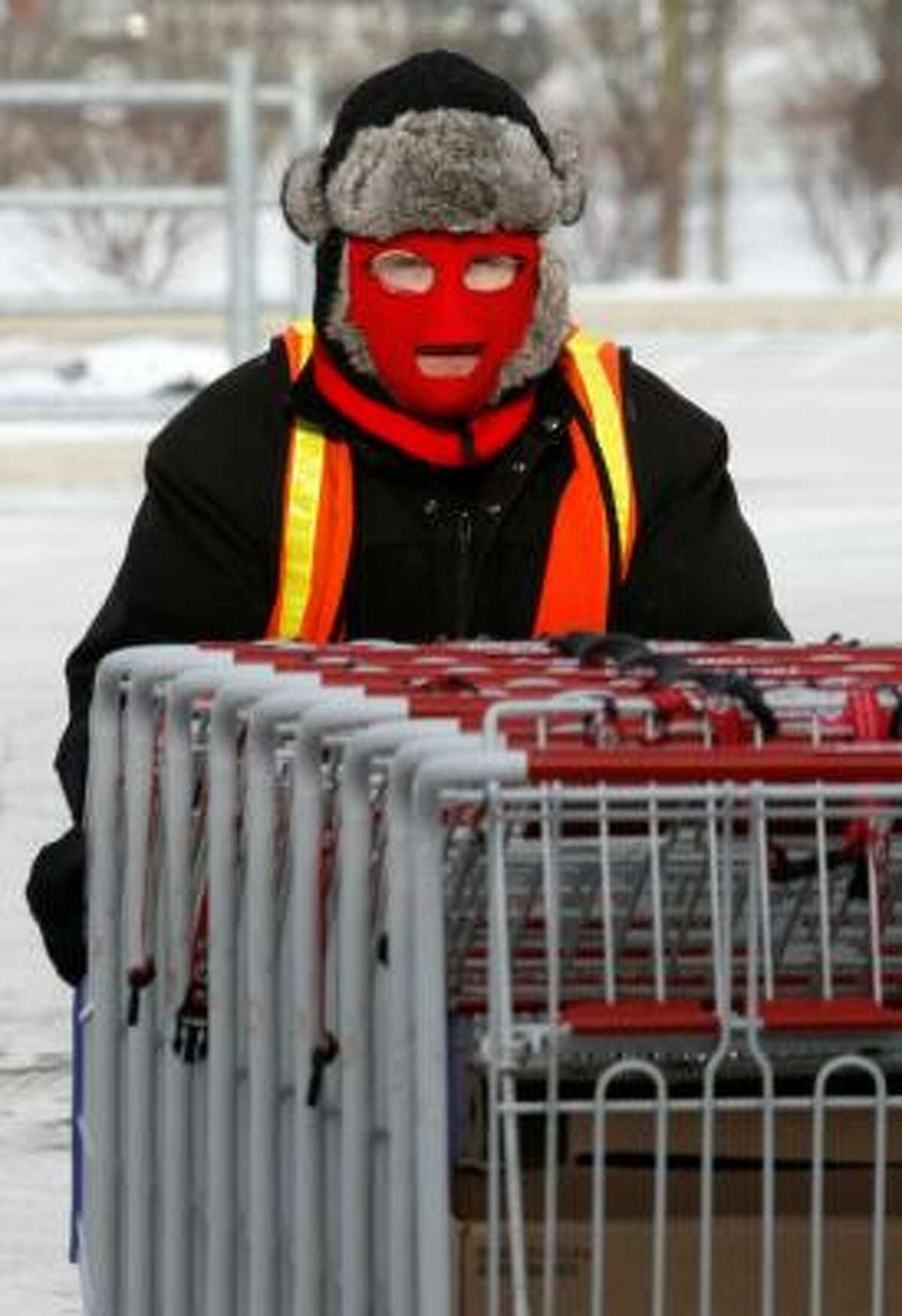 Gathering shopping carts in a Costco parking in Homestead, Pa., was a cold job with temperatures topping out at 5 degrees in the Pittsburgh area.