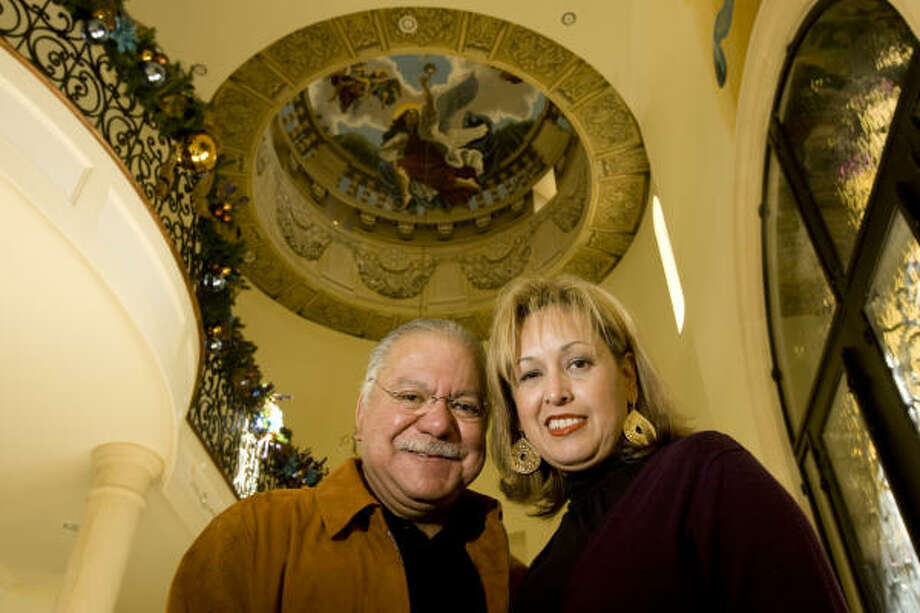To honor God, Louis and Alicia Varela of Spring commissioned three huge murals of angels. Photo: Melissa Phillip, Chronicle