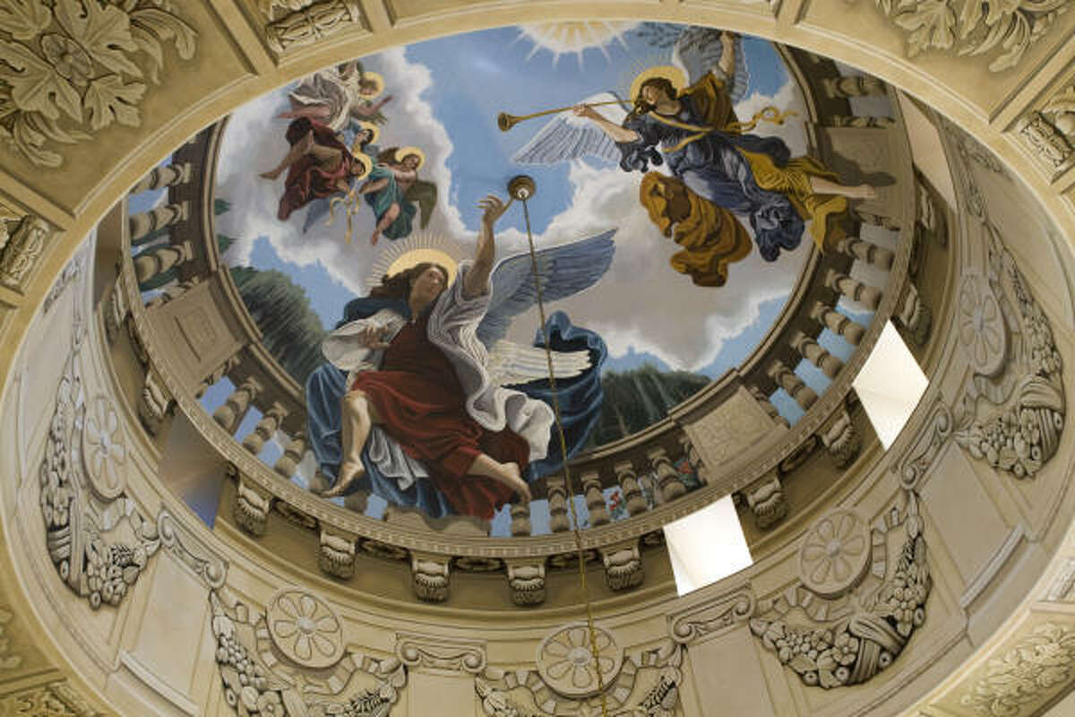 Eight artists from Imago Dei spent three months painting this dome, right above the Varela's staircase, in trompe l'oeil style.