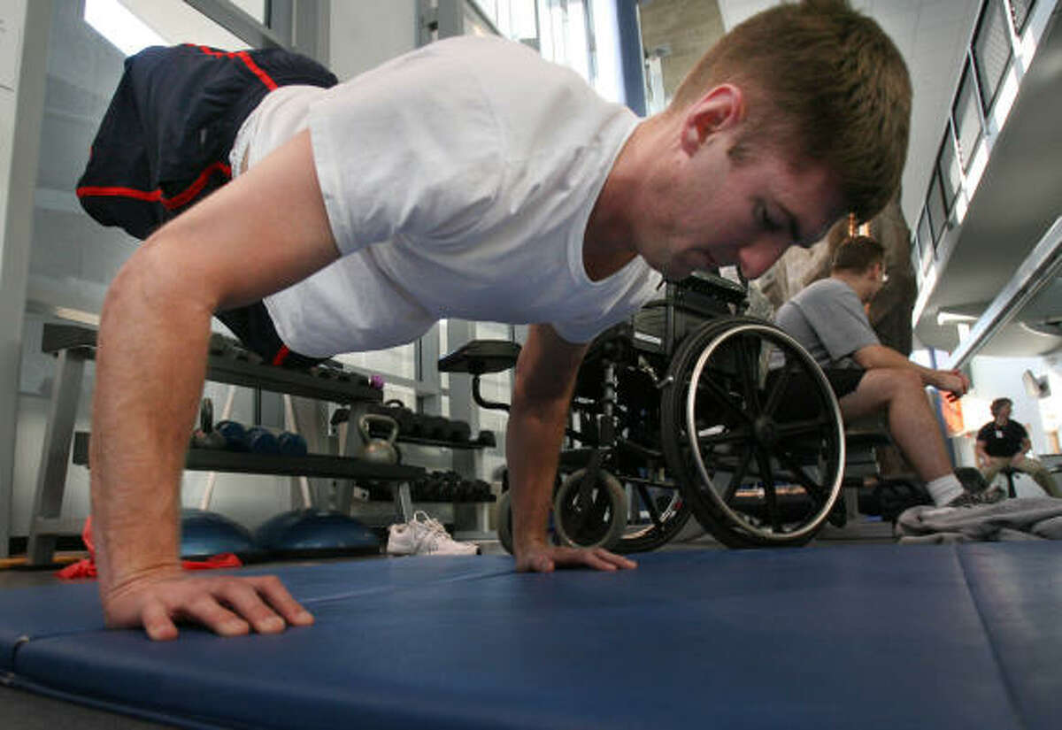 Cpl. Travis Dodson doesn't often talk about the grenade that took his legs or the day it happened, but he's always pushing himself harder to do more in his wheelchair.