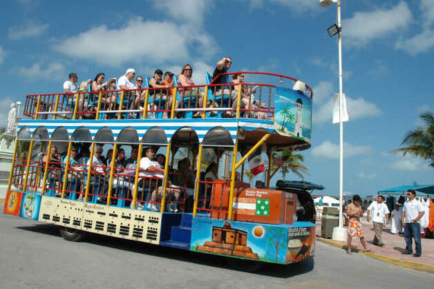 Tour the Mexican beach resort of Progreso in style on a colorful hop-on, hop-off open-air bus. Progreso is on the northern tip of the Yucatan Peninsula, facing the Gulf of Mexico, and has become a popular cruise port. Photo: Harry Shattuck, HOUSTON CHRONICLE