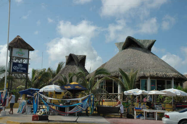 The fun in Progreso, along the Gulf Coast on the northern tip of the Yucatan Peninsula, is centered along a beach promenade known as the Malecon and lined with restaurants and shops. Photo: Harry Shattuck, HOUSTON CHRONICLE