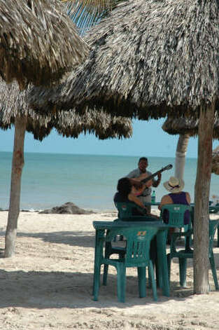 The fun in Progreso is centered along a beach promenade known as the Malecon and lined with palm trees, restaurants and watering holes. Strolling musicians may even provide a serenade. Photo: Harry Shattuck, HOUSTON CHRONICLE