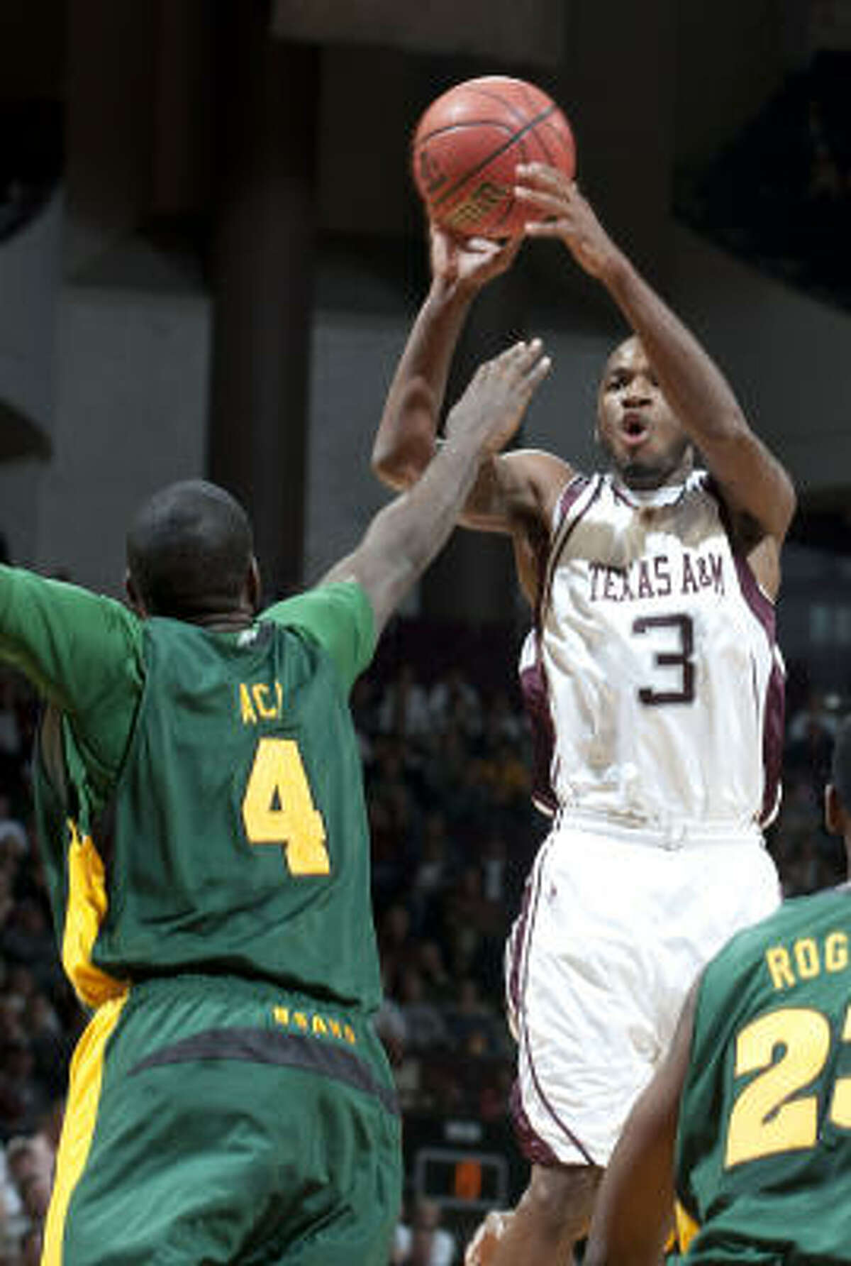 Texas A&M's Derrick Roland (3) goes up for a basket over Baylor's Quincy Acy (4) during the first half.