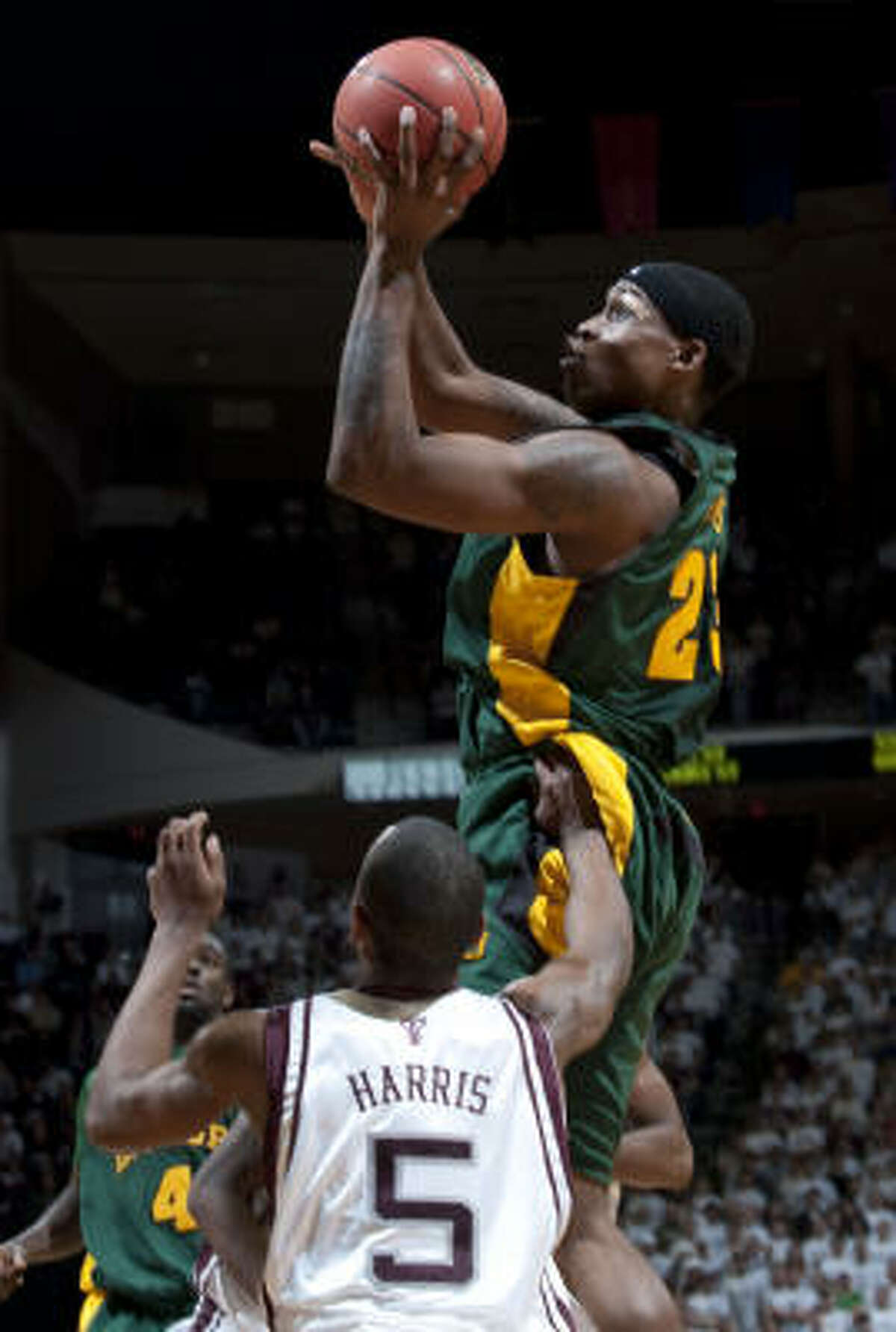 Baylor's Kevin Rogers (23) shoots over Texas A&M's Dash Harris (5) during the second half.