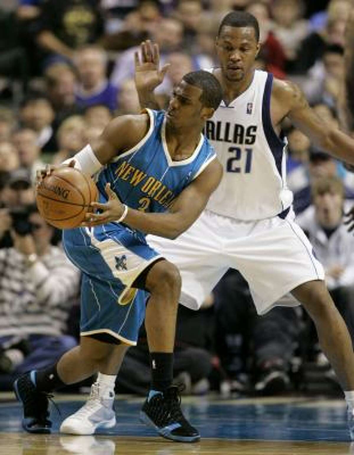 Chris Paul nearly showed Jason Kidd what a quadruple-double looks like, putting up 33 points, 11 assists, 10 rebounds and seven steals in the New Orleans Hornets' 104-97 victory over the slumping Dallas Mavericks on Wednesday night.