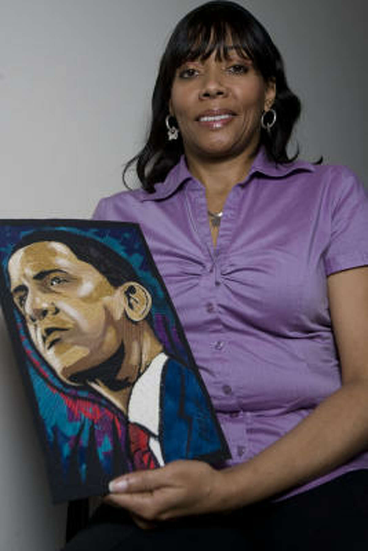 Carolyn Crump poses for a portrait with one of her quilt pieces. Crump's quilt is in