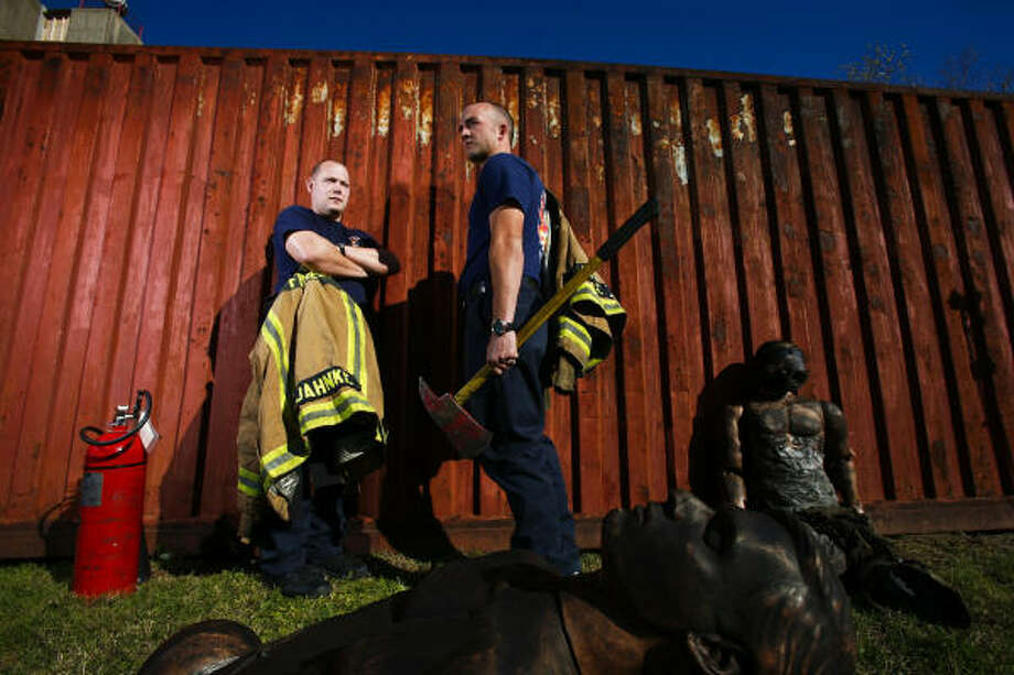 Chris Jahnke, left, and his cousin Greg Jahnke are two cadets in HFD's current class of recruits learning to fight fires at the HFD training center named for one of their relatives. Photo: Michael Paulsen, Chronicle