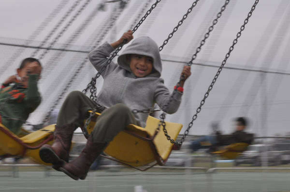 Mark Jacobs, 6, enjoys one of the rides at the Winterfest that was held at Independence Park in Pearland. The event was sponsered by the Pearland Parks and Recreation.