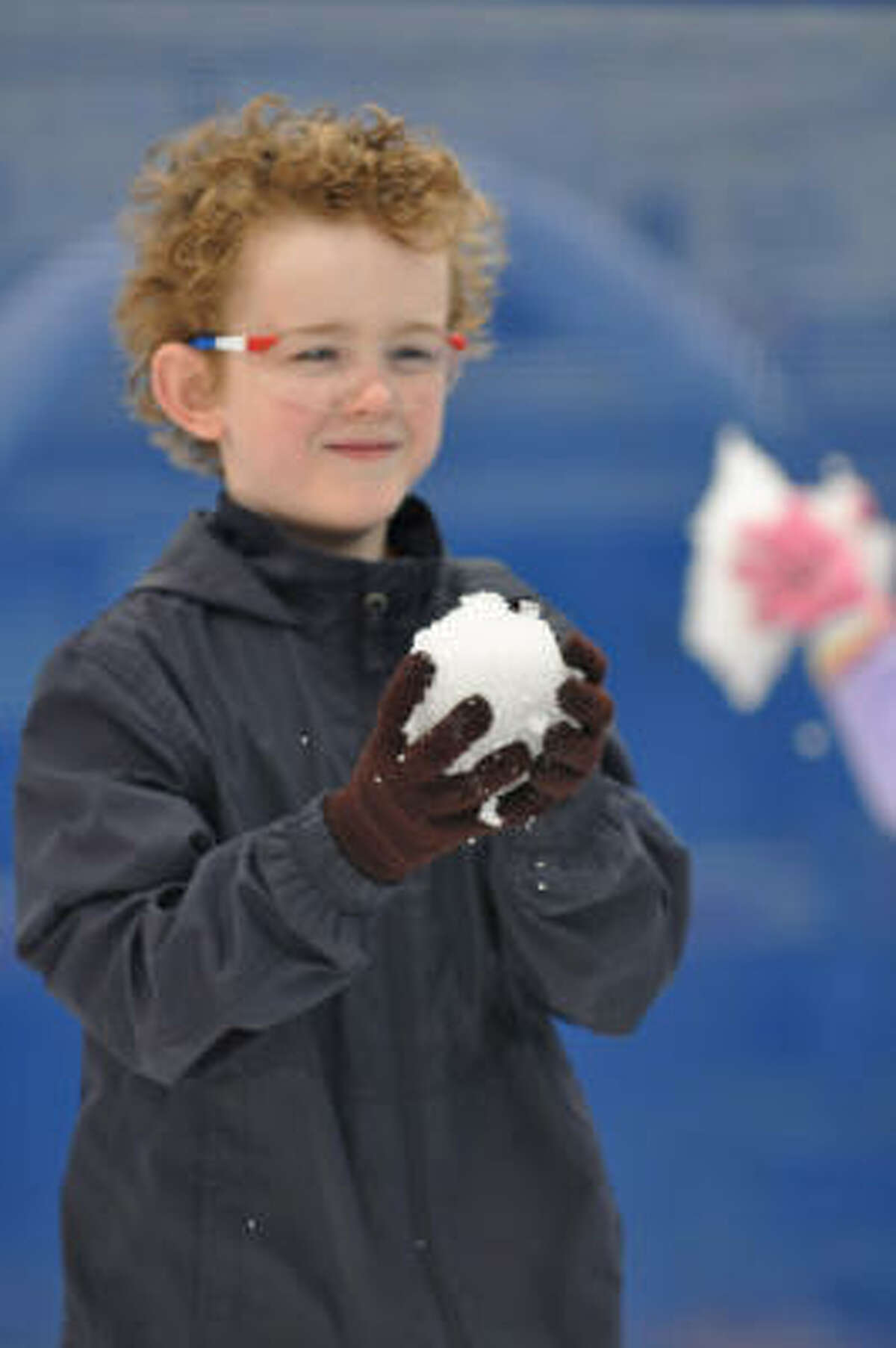 Wyatt Duhon age 9 enjoys the snow at the Winterfest that was held at Independence Park in Pearland. The event was sponsered by the Pearland Parks and Recreation.