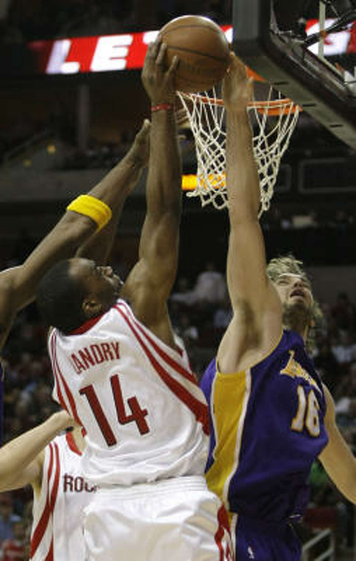 Lakers forward Pau Gasol rejects a shot by Carl Landry (14) in the second half.