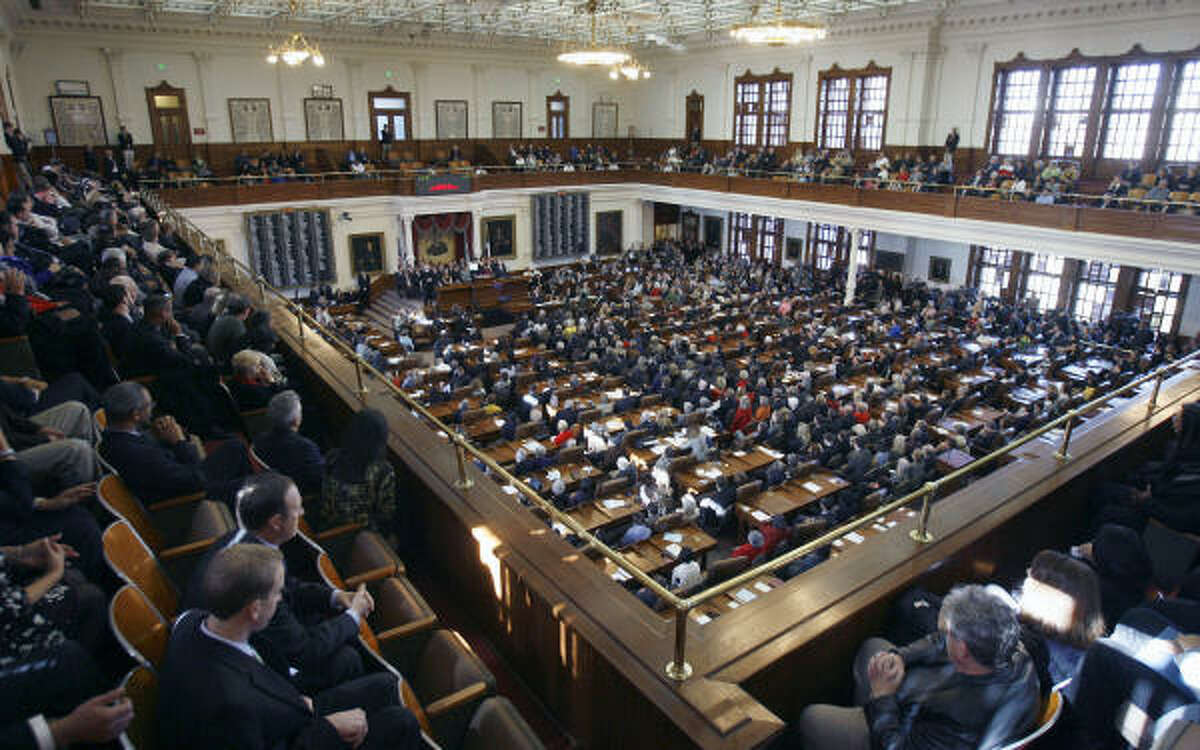 The chamber of the Texas House of Representatives, filled with lawmakers and spectators.