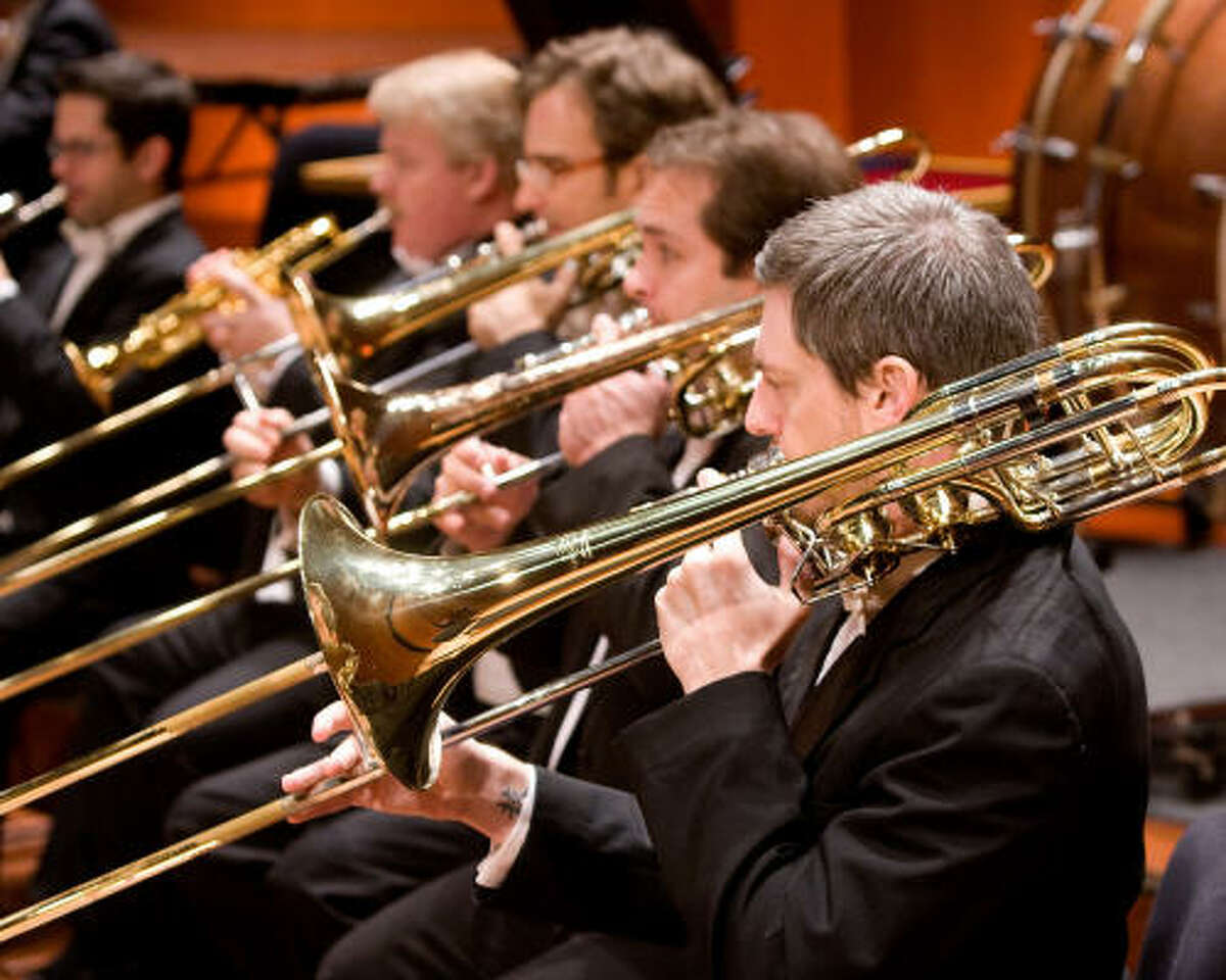 The horn section of the Houston Symphony. The 2009/2010 season, announced this week draws from the future and history with performances paired with high definition films and standard favorites from classical music's repertoire.