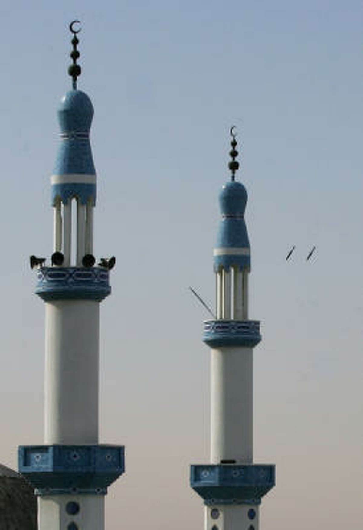 Two missles (back right) fired by an Israeli airforce jet fall behind a mosque during an Israeli airstrike in the southern Gaza Strip town of Rafah near the border with Egypt on Jan. 13.