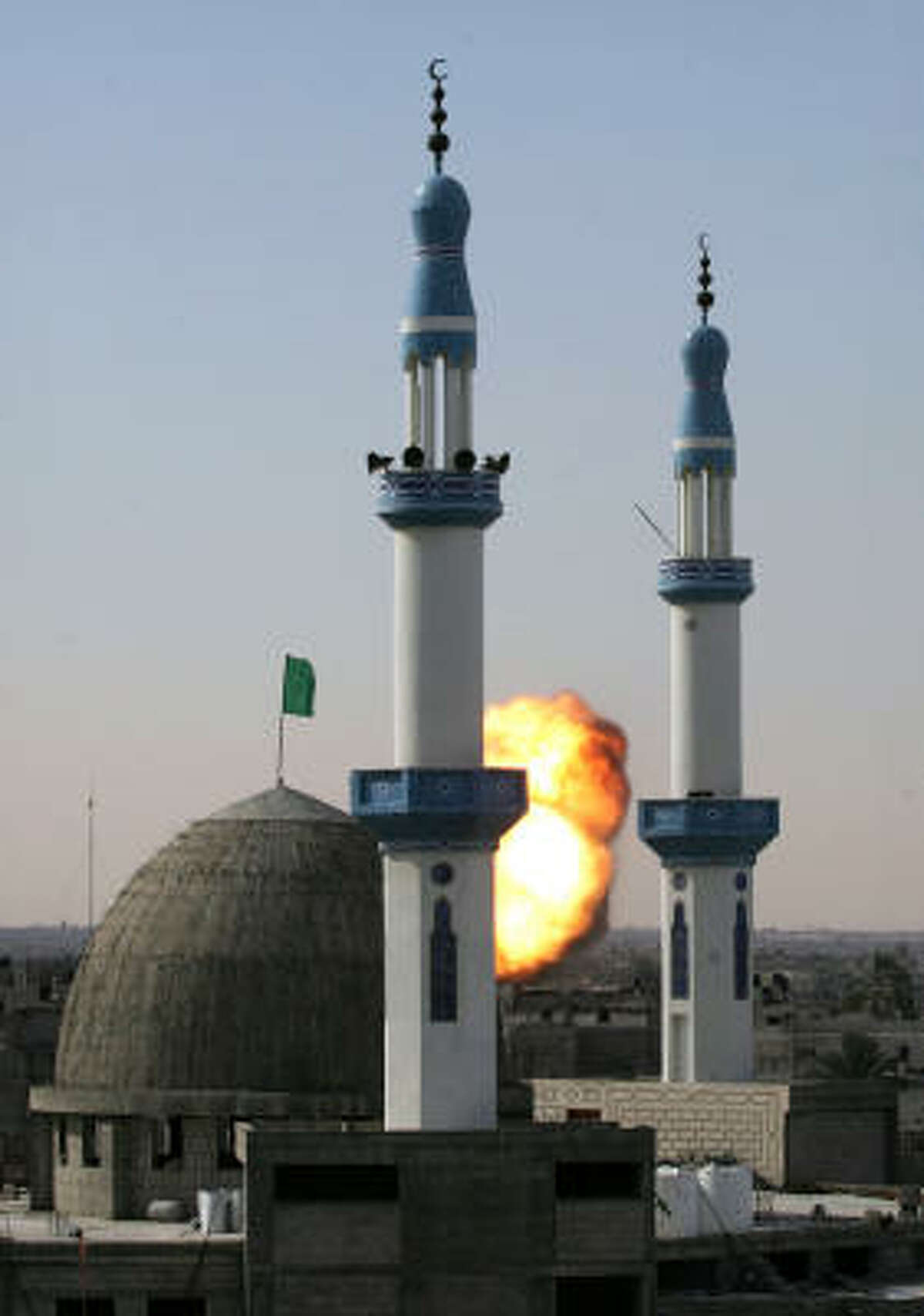 An explosion is seen behind the mosque after the Israeli airstrike in Rafah on Jan. 13.