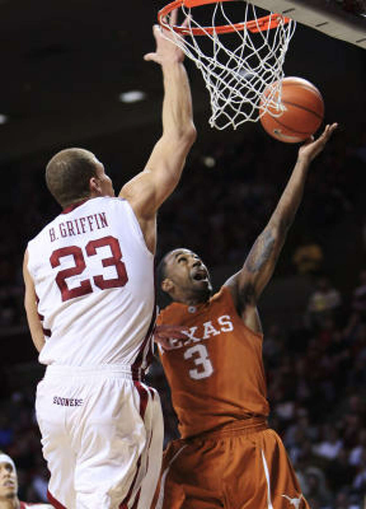 Texas guard A.J. Abrams, right, goes up for a layup in front of Oklahoma forward Blake Griffin during the first half.