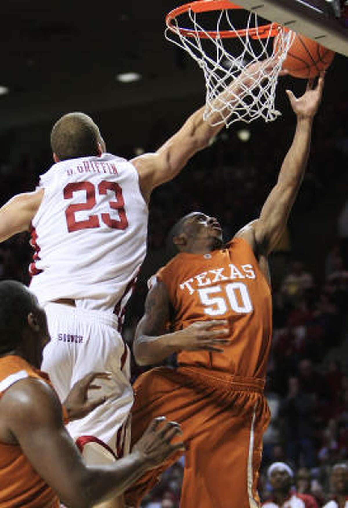 Oklahoma forward Blake Griffin, left, reaches to block a shot by Texas guard Varez Ward.