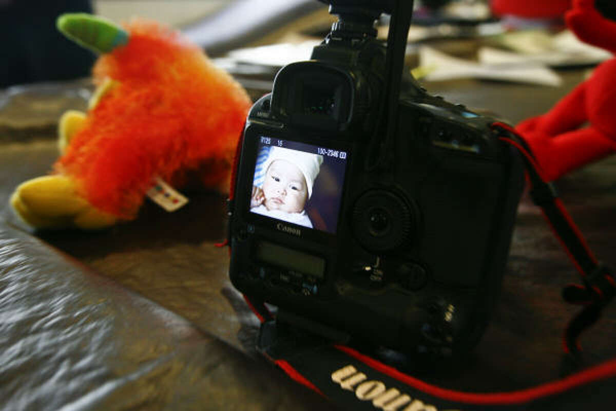 Photographer Sofía van der Dys' camera sits next to toys used in a photo shoot of 6-month-old Daniel Ojeda at Texas Children's Hospital.