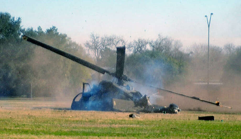 Debris flies after the Army aircraft's accident. The helicopter was taking part in the ROTC Winter Field Training Exercises when the crash occurred. Photo: Dave McDermand, Bryan-College Station Eagle