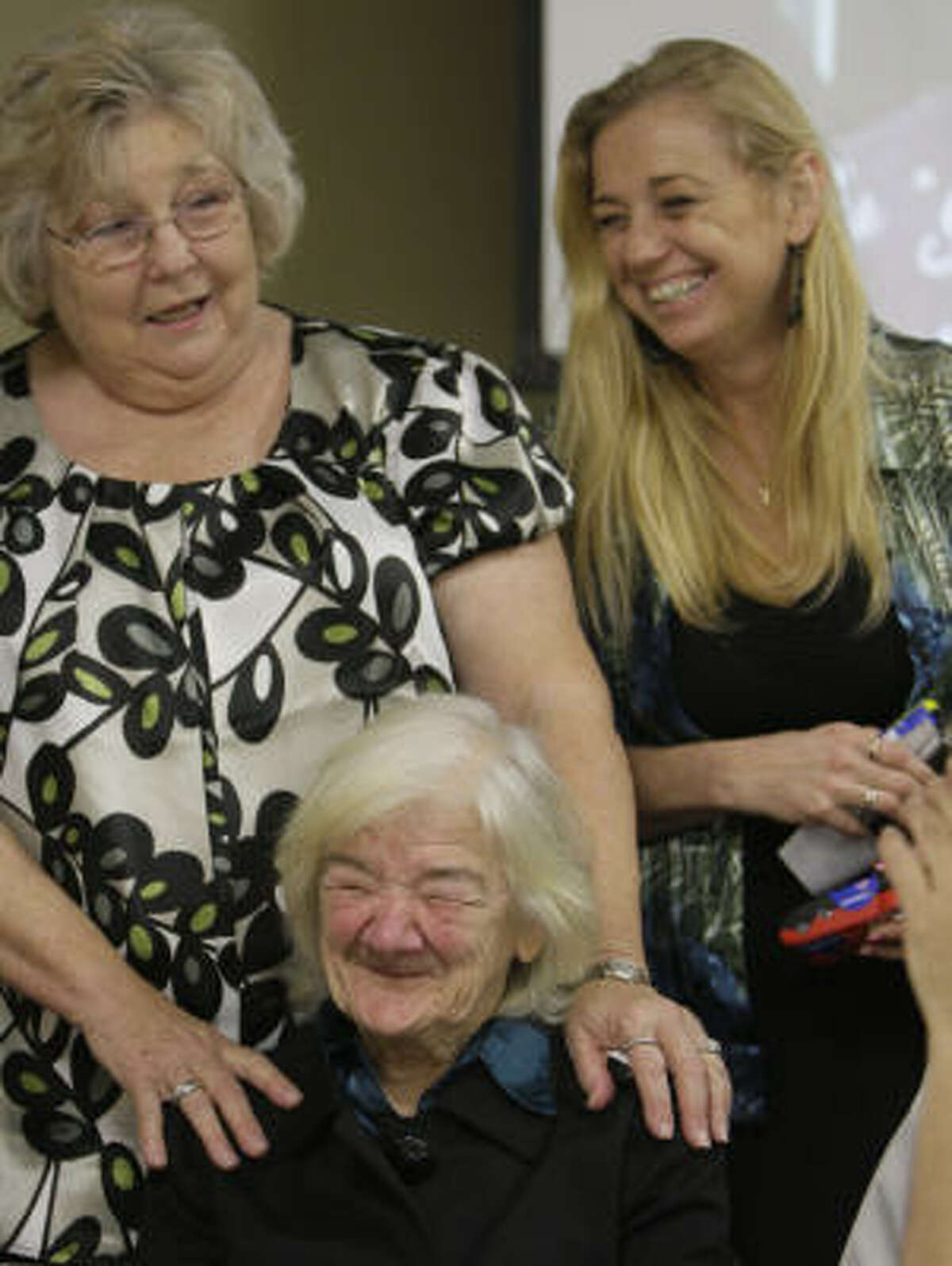 Ruby Ardoin, left, Laurie Corder, right, and Mary Selix, sitting, recall a humorous family story as they talk after a memorial service for Jennifer McLemore Jan. 3 in Beaumont.