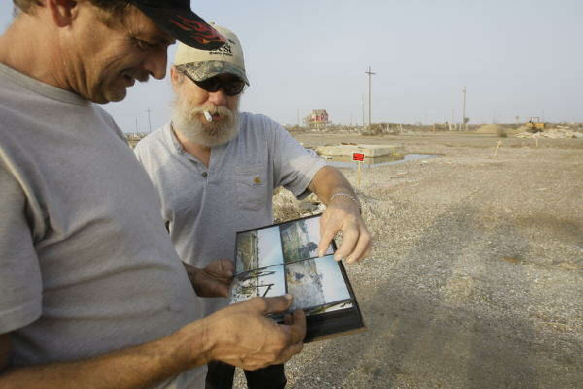 Mark Gassiot, left, and Curtis Morgan look at a photo album Jan. 4 of Curtis' home before and after Hurricane Ike. Curtis is the next-door neighbor to Mark's mother, Jennifer McLemore, on Seagull Lane in Gilchrist.
