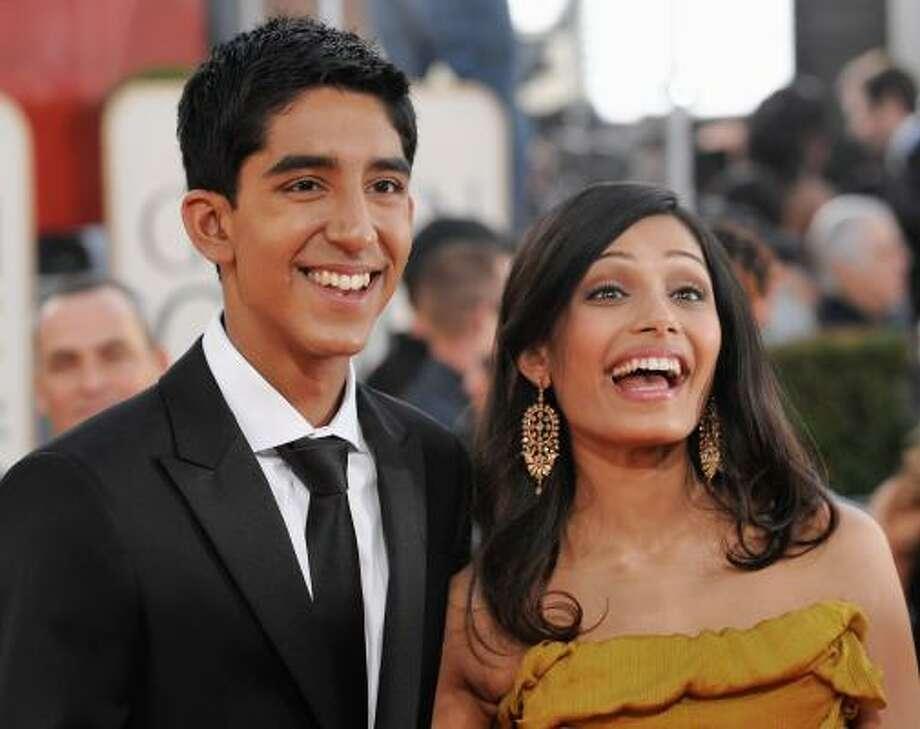 Dev Patel and Freida PintoDev Patel and Freida Pinto played a romantic duo in 'Slumdog Millionaire.' Photo: Chris Pizzello, AP