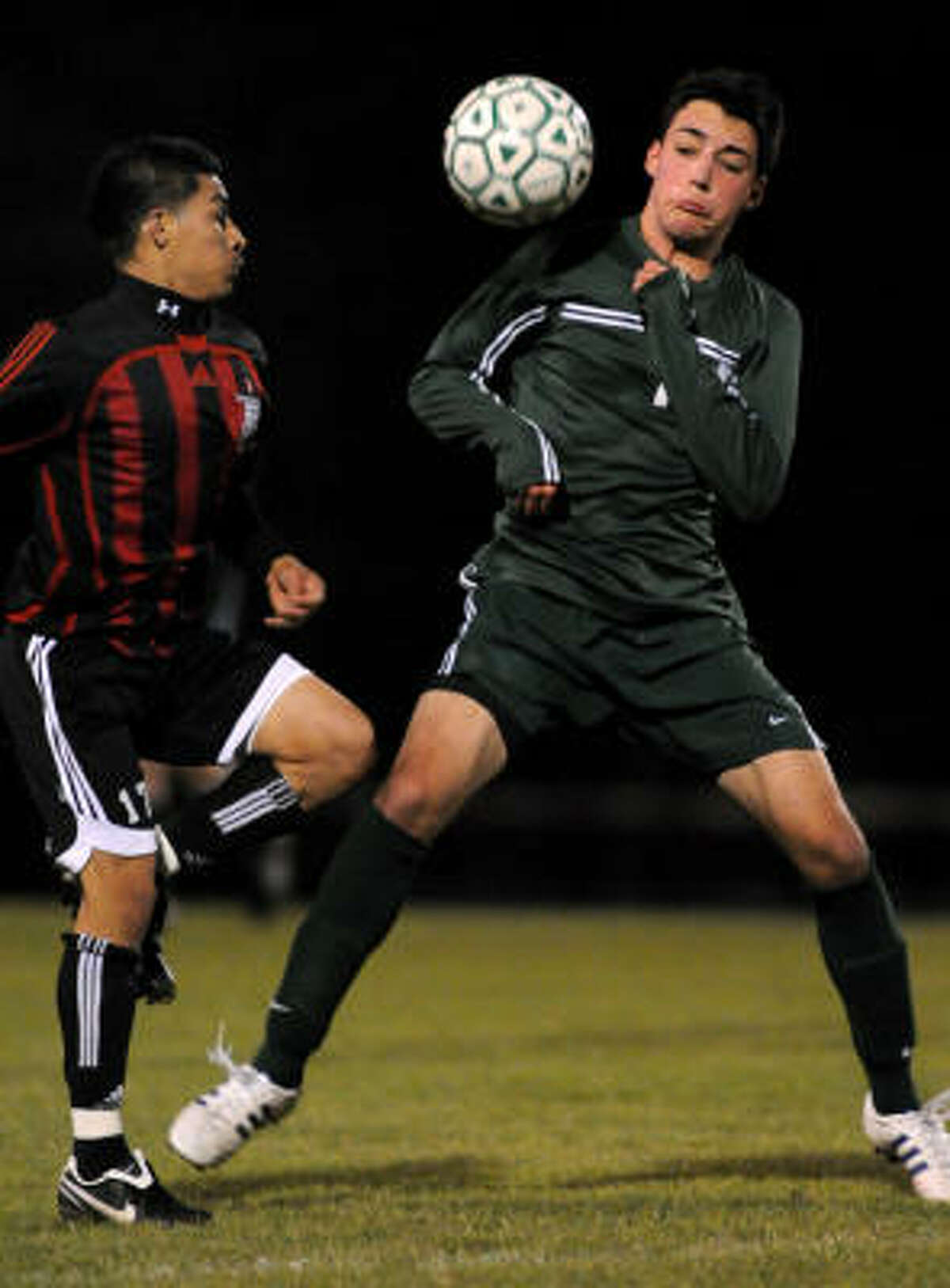 The Woodlands senior defender Max Miller, right, goes one-on-one against Westfield senior forward Fredy Agueta.