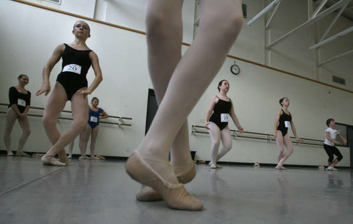 Audrey Linnartz, of Houston, Sarah Murphey, of Tomball, and Torrance Cobb, of Beaumont, audition. SAB's former students fill the ranks of the New York City Ballet and other leading U.S. and international ballet companies.