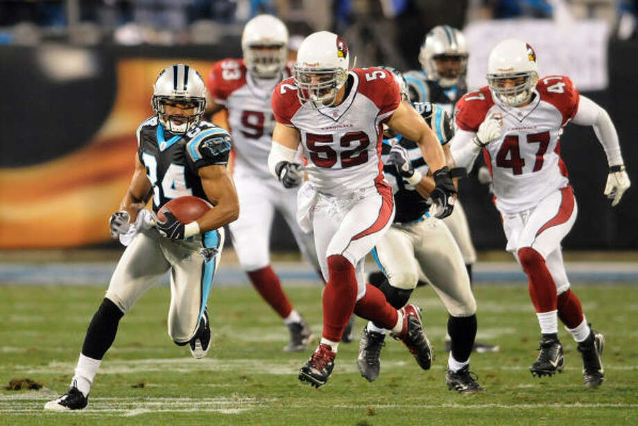 Cardinals 33, Panthers 13 Carolina Panthers returner Mark Jones takes the ball up the field on the opening kickoff against the Arizona Cardinals. Photo: David T. Foster III, MCT