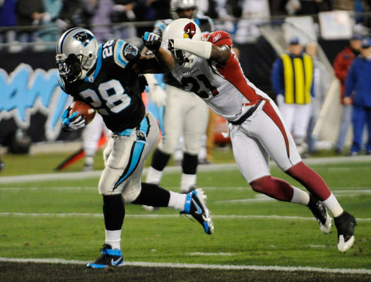 Panthers running back Jonathan Stewart scores against the Arizona Cardinals on a 9-yard run.
