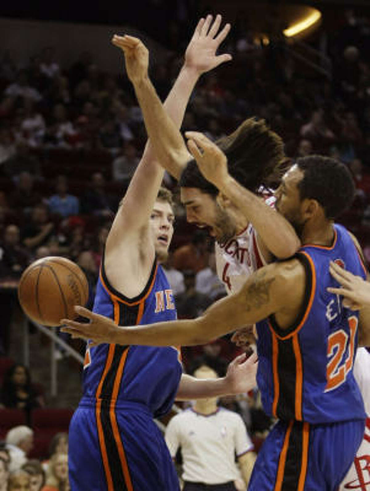 Luis Scola, center, battles two Knicks defenders, David Lee, left, and Jared Jeffries, for a rebound off his own miss in the first half.