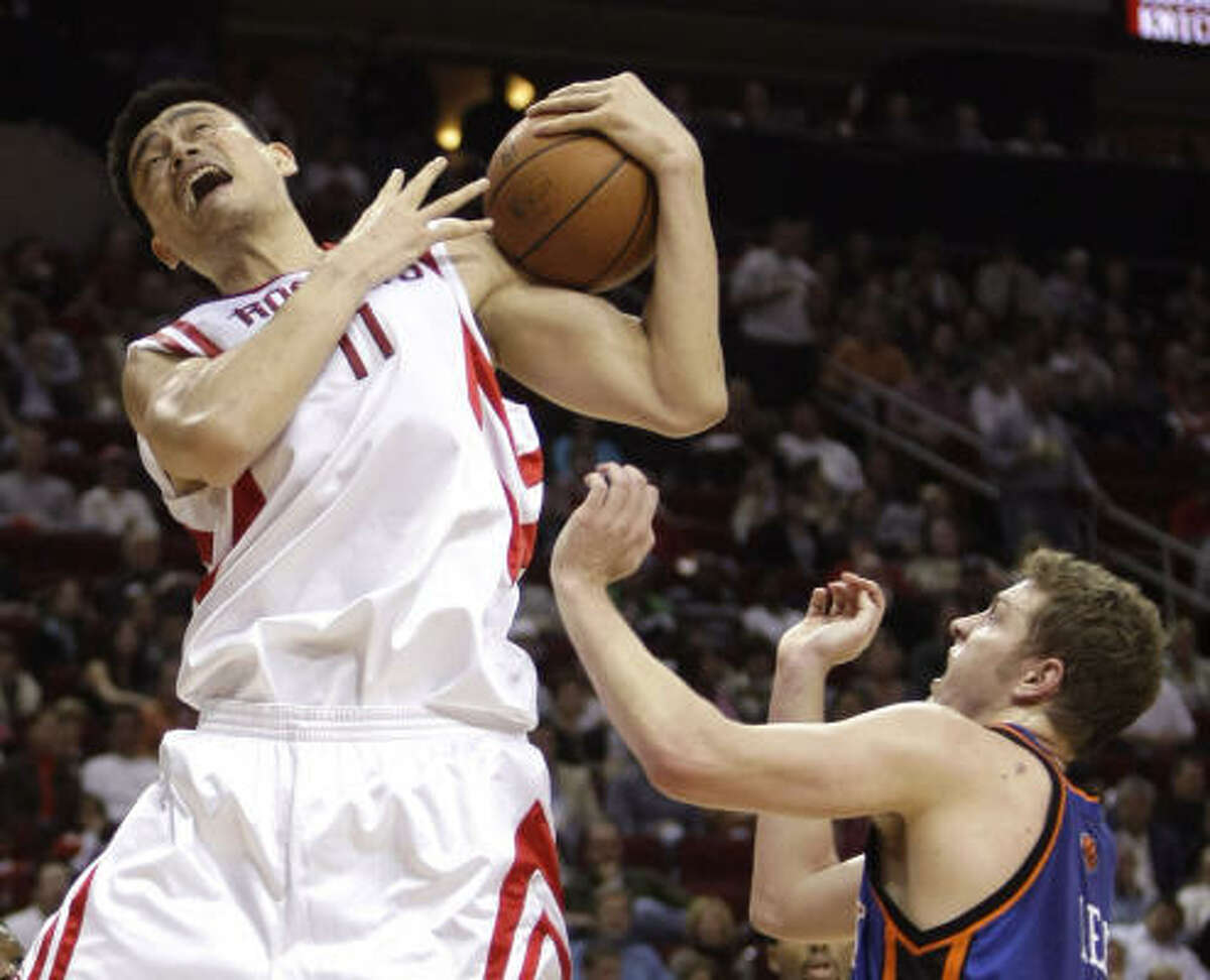 Yao Ming, left, efforts for a rebound against Knicks center David Lee in the first half.