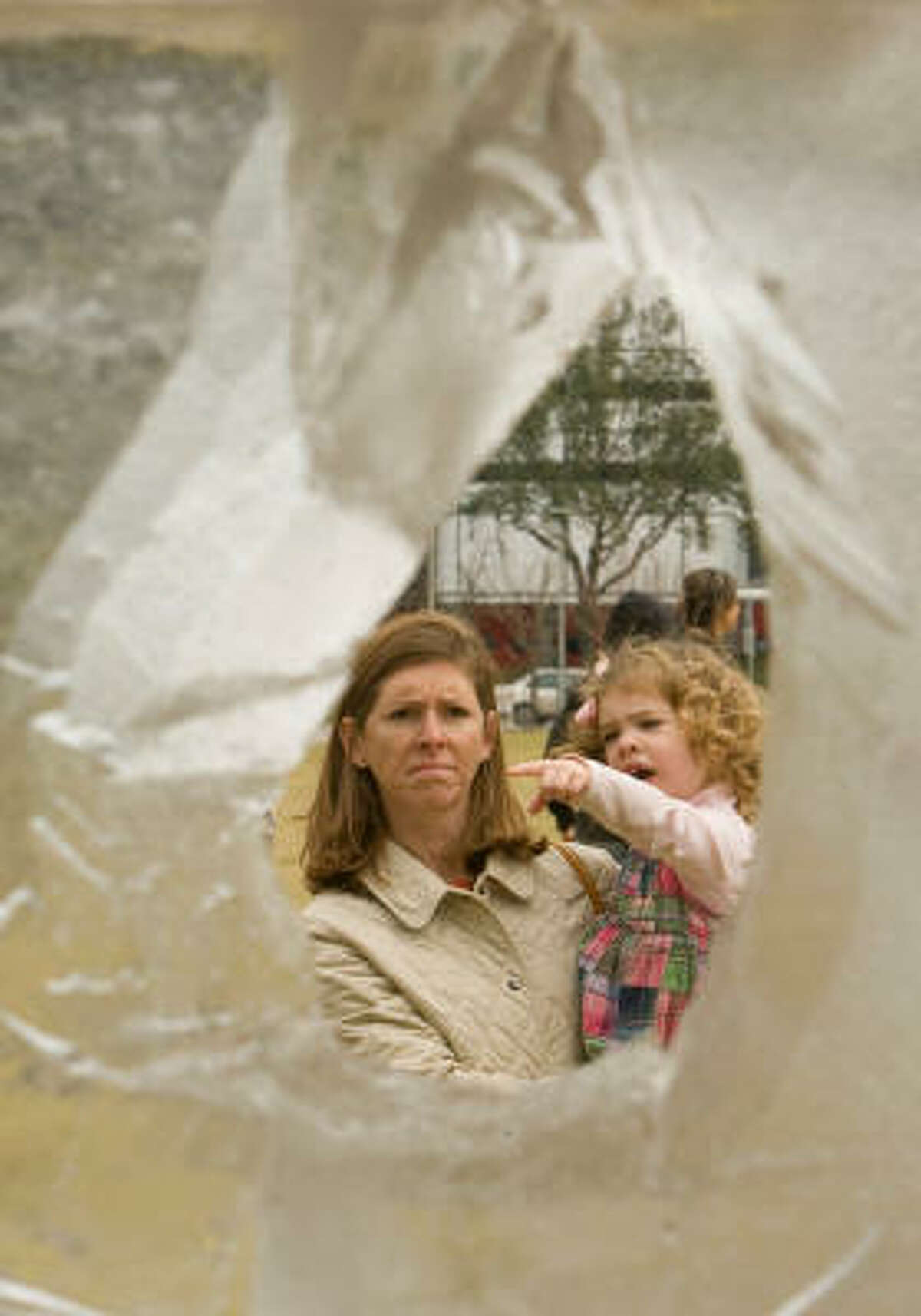 Leslie Wade of Houston and her 2-year-old daughter, Elizabeth Wade, look at some of the ice sculptures. Seven acclaimed ice sculptors carved, shaved and sculpted 7 tons of ice in Houston's inaugural ice sculpting competition.