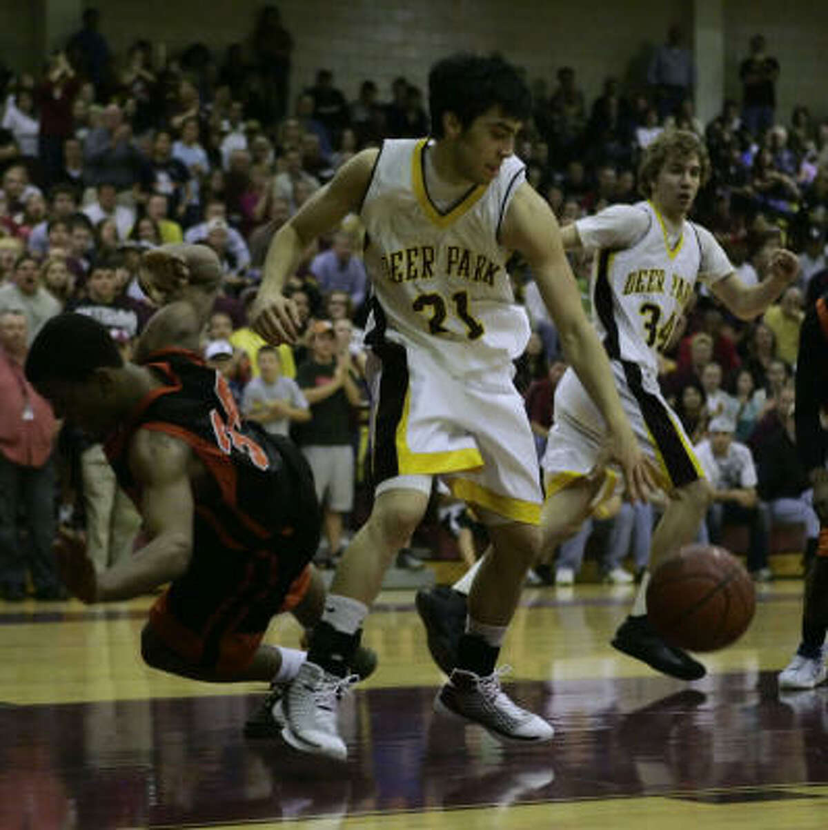 Deer Park senior guard Adrian Morales comes up with a loose ball late in the fourth quarter.