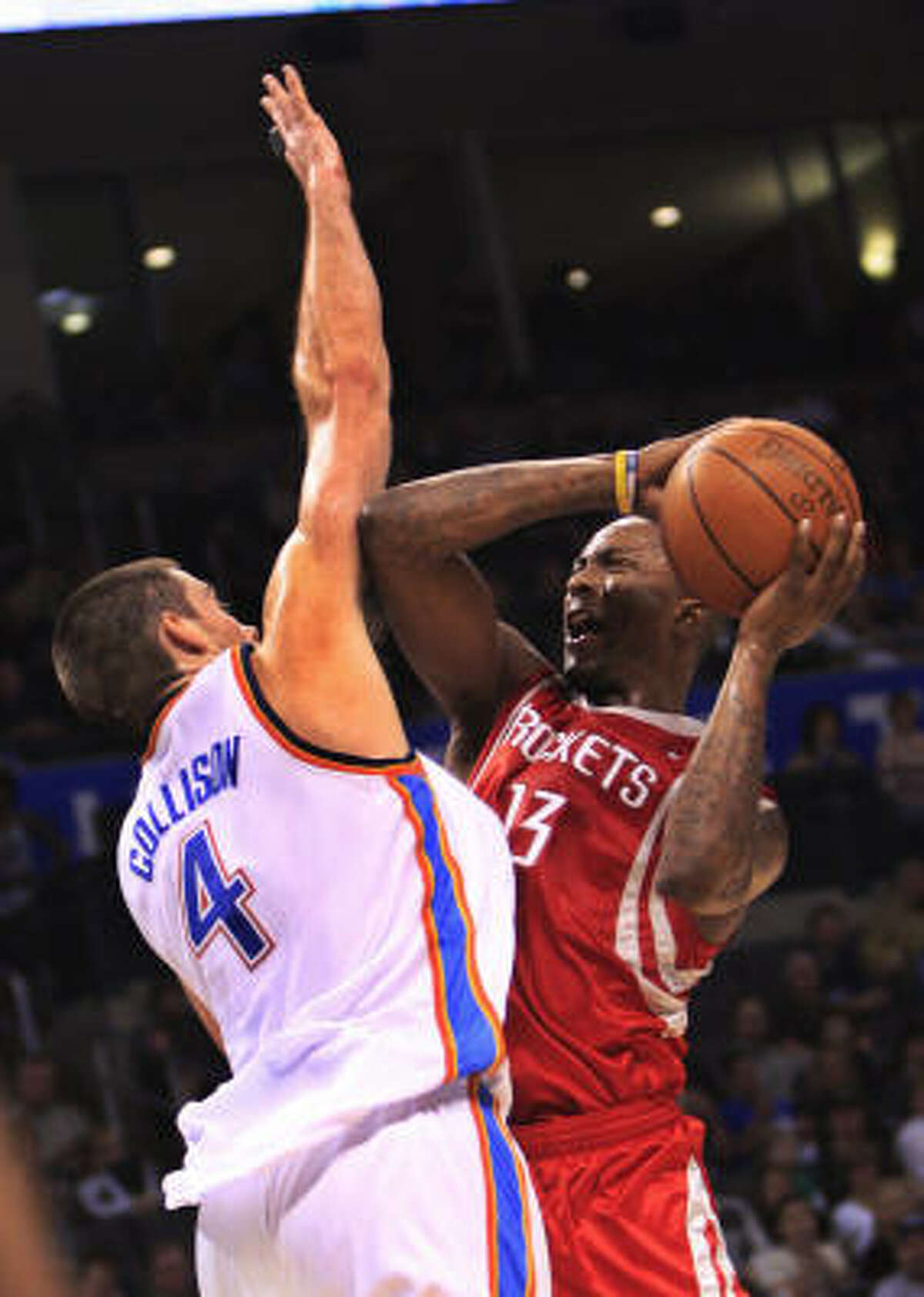 Von Wafer, right, started for the second straight game for the Rockets. Here, he looks to shoot over Thunder forward Nick Collison in the first quarter.