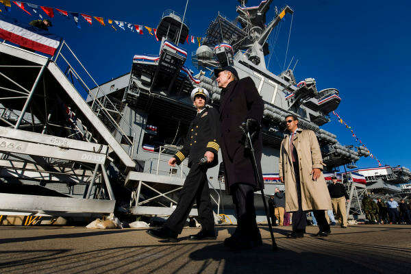 Capt. Kevin E. O'Flaherty, the commanding officer of the USS George H.W. Bush, left, walks with former President George H.W. Bush as he arrives for a tour of his namesake aircraft carrier in Norfolk, Virginia.