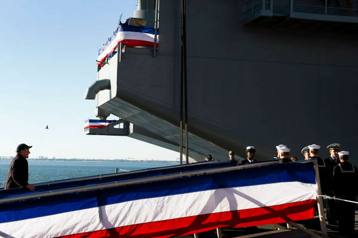 Former President George H.W. Bush walks up the gangplank for a tour of the ship. The Navy's newest nuclear-powered aircraft carrier will be commissioned during a ceremony at Naval Station Norfolk.
